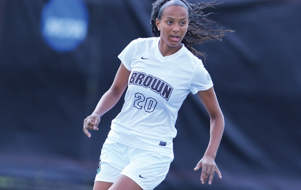 Photo of Sydney Cummings '21 playing soccer in her Brown team uniform (number 20)
