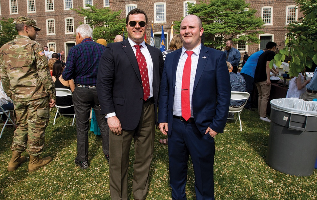 Scott Quigley '05, mentor, and  Davin Lewis '19, mentee, after the commissioning ceremony.