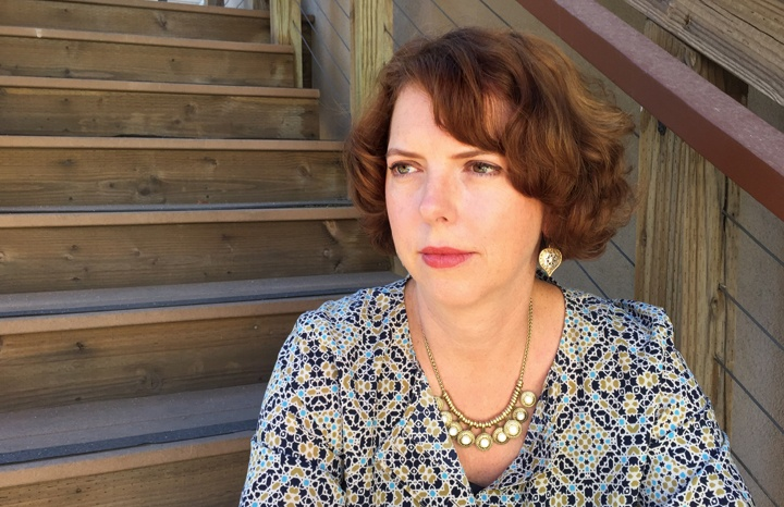 Photography of Susan Valoff sitting on some stairs.