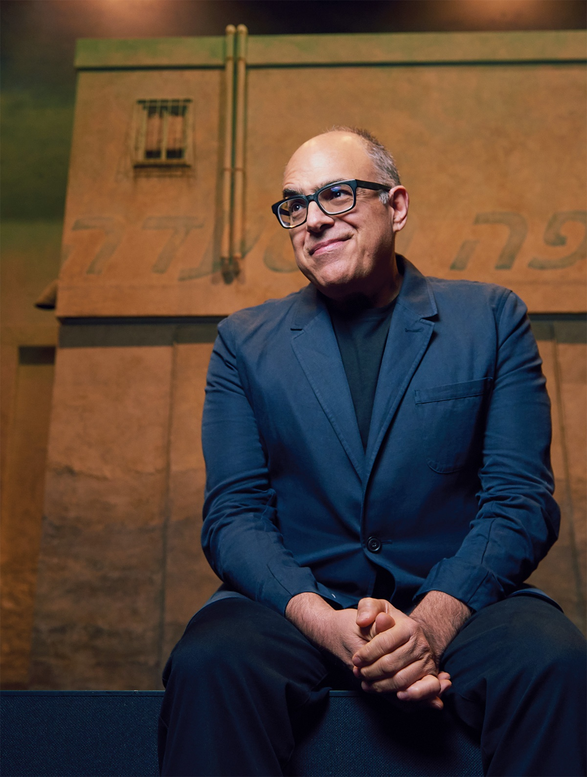 Photograph of David Yazbek in a blue suit.