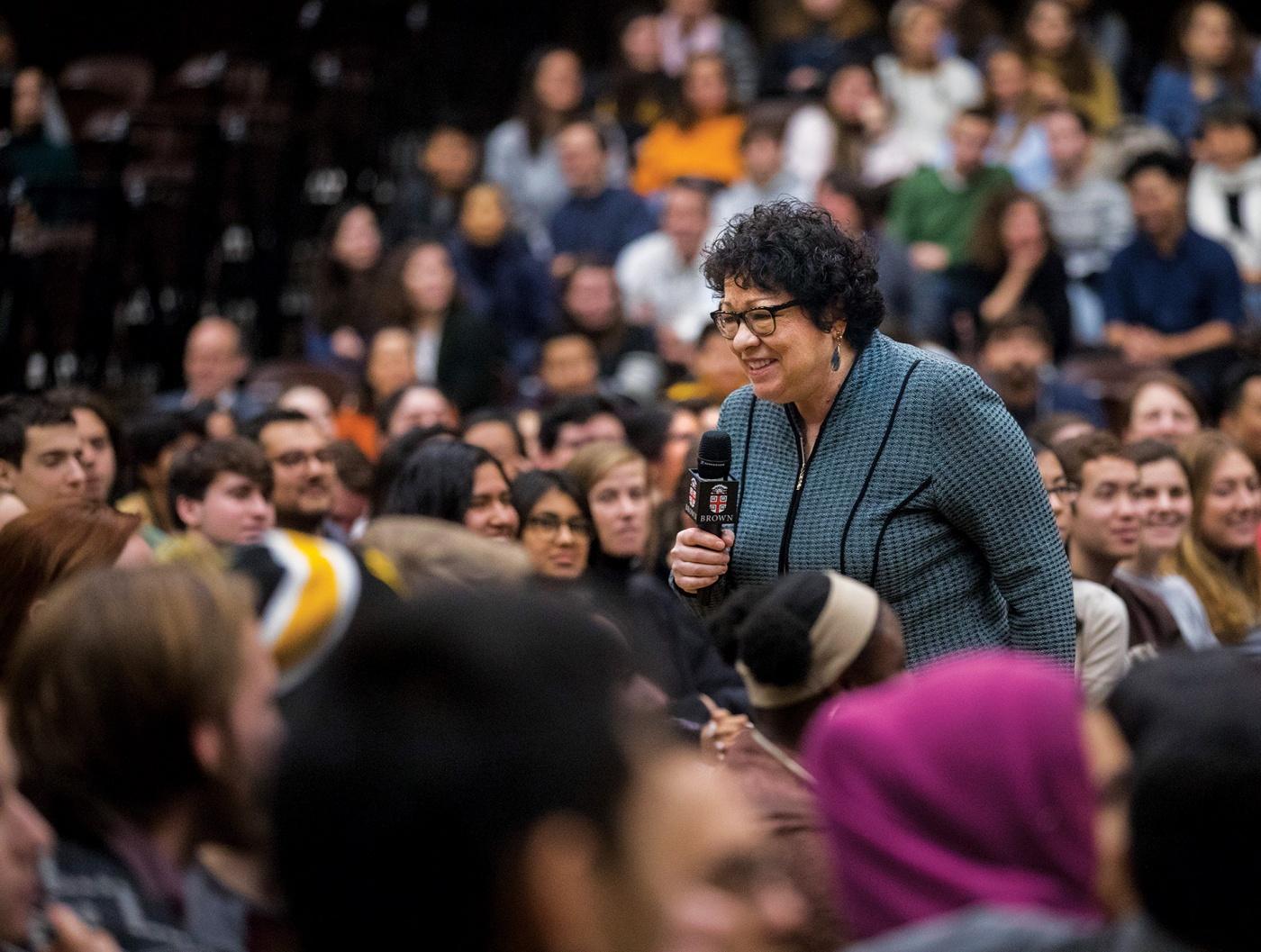 Justice Sonia Sotomayor walking among Brown students