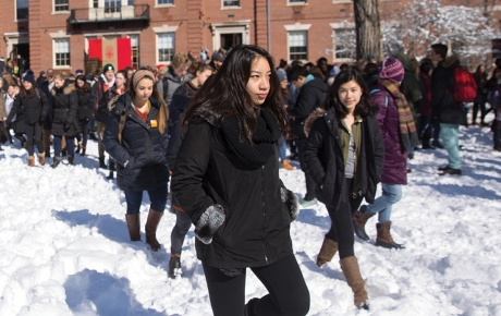 Students on the main green in the snow.