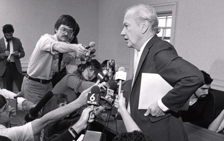 Bob Reichley surrounded by journalists